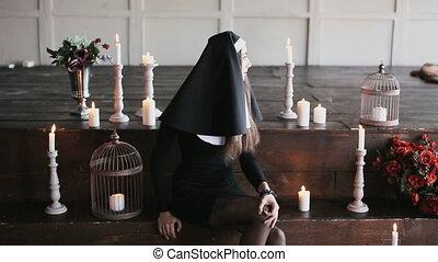 sexy bad nun in church - sexy bad nun sitting in church