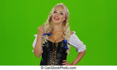 Sexy bavarian girl playing with her hair. Green screen