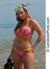 Sexy beach bikini girl wearing scuba gear