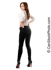 Sexy beautiful girl in black tight jeans. Isolated on white