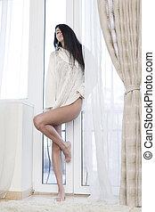 Sexy beautiful woman beside window