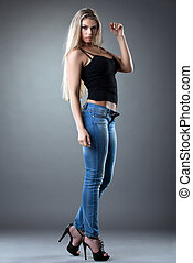 sexy Beautiful woman posing in jeans