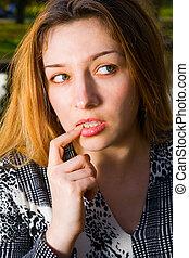 Sexy beautiful woman thinking
