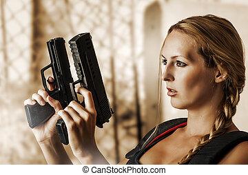 Sexy beautiful woman with guns