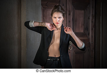 Sexy beautiful young woman in a black suit