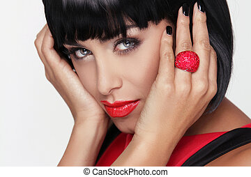 Sexy beauty brunette woman with Red Lips. Makeup. Stylish Fringe. Black Short Hair Style. Jewelry. Fashion photo