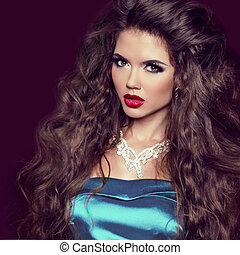 Sexy Beauty Girl with Red Lips. Make up. Luxury Woman with Jewelry. Fashion Brunette Portrait isolated on dark background.