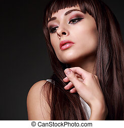 Sexy beauty woman face with long gloss hair on dark...