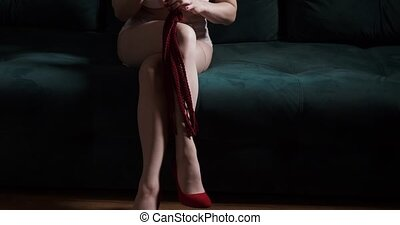 Sexy blond dominant woman sitting and waiting submissive...