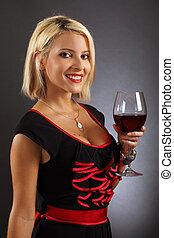 Sexy blond drinking red wine