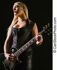 Sexy blond female playing electric guitar