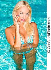 Sexy Blond Girl Posing in Swimming Pool