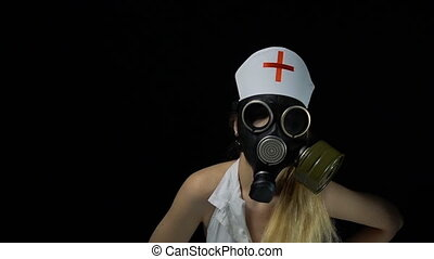 Sexy blond nurse in gas mask - Footage of sexual young nurse...