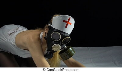 Sexy blond nurse with gas mask in bed - Footage of sexual...