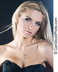 Sexy blond - Portrait of beautiful young girl with long...