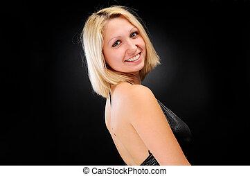sexy, blond, posierend, aus, dunkler hintergrund
