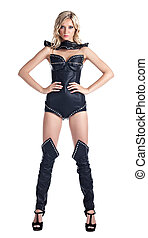 Sexy blond woman in leather corset stand isolated