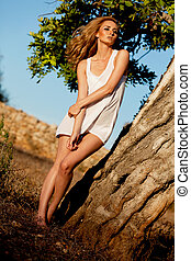 sexy blond woman outdoor in summer heat