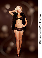 Sexy blond woman posing in lingerie, full fashion portrait
