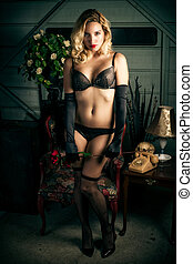 Sexy Blond Woman Wearing Black Lingerie - A young, beautiful...