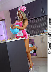 Sexy blonde baker girl in kitchen