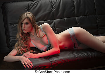 sexy blonde girl lying on sofa
