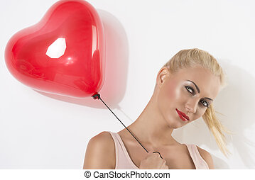 sexy blonde girl with balloon smiles