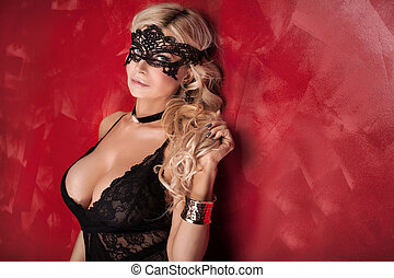Sexy blonde lady posing in lingerie.