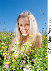 Sexy blonde on background meadow