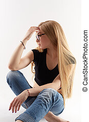 Sexy blonde wearing glasses, isolated on white