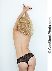 Sexy blonde woman in black lingerie