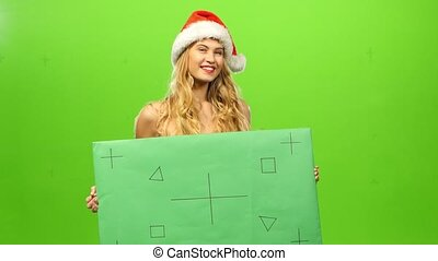 sexy blonde woman in Santa hat, green screen, blank sign, mask at party, New Year
