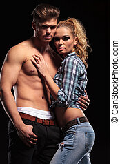 Sexy blonde woman leaning on her topless boyfriend