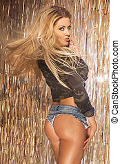 Sexy blonde woman looking at camera
