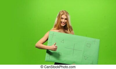 Sexy blonde woman on green screen, blank sign