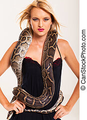 sexy blonde woman posing with python