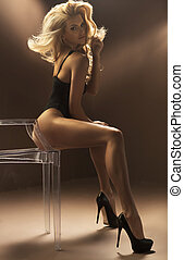 Sexy blonde woman sitting on crystal chair - Sexy blonde...
