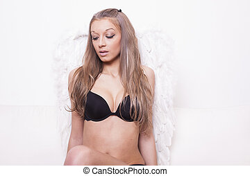 Sexy blonde woman with angel wings