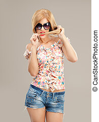 sexy blonde woman with sunglasses posing