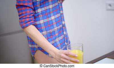 Sexy Bottomless Woman Drinking Orange Juice