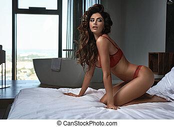sexy, brünett, junge frau, tragen, rotes , damenunterwäsche