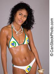Sexy brazilian - Beautiful brazilian girl in bikini on grey...