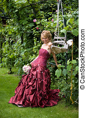 Sexy bride - Beautiful blond bride leaning on a railing in a...
