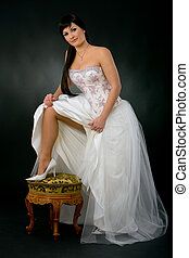 Sexy bride - Beautiful bride showing her leg in white shoe.