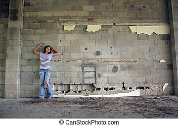 Sexy Brunette at a Block Wall