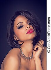 sexy brunette elegant model portrait wearing necklace