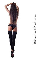 Sexy brunette girl in black bikini with long hairs