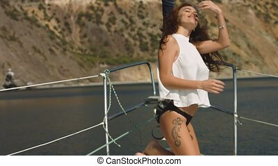 Sexy brunette girl in white blouse on luxury yacht - Sexy...