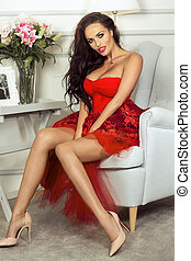 Sexy brunette lady in red dress. - Sexy brunette woman with...