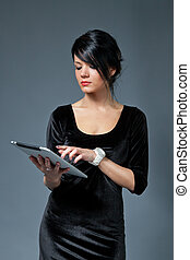 Sexy brunette model using new touch pad device. One of collection.